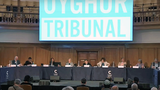 Members of the Uyghur Tribunal, a panel of UK-based lawyers, academics, rights experts, and business practitioners investigating alleged human rights violations and reports of genocide targeting Uyghurs in China's Xinjiang region, hear testimony from witnesses, in London, Sept. 13, 2021.