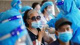 A Vietnamese woman receives the AstraZeneca COVID-19 coronavirus vaccine in Vietnam's capital Hanoi, Sept. 10, 2021.