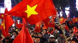 Vietnamese soccer fans wave the national flag in a Jan. 23, 2018 photo.