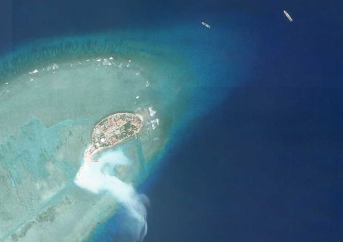 Satellite imagery shows work taking place on the southern tip Pearson Reef in the South China Sea on Friday.
