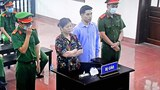 Vietnamese land-rights activists Can Thi Theu (left) and Trinh Ba Tu are shown at their trial in Hoa Binh province, May 5, 2021.
